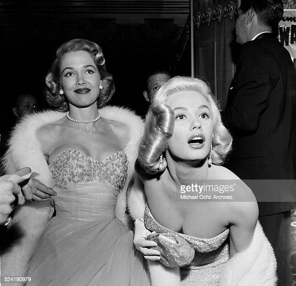 Actress Mamie Van Doren and Sara Shane attend the movie premiere of The Glenn Miller Story in Los AngelesCA