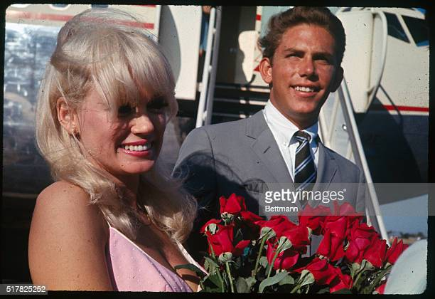 Actress Mamie Van Doren arrives in Sacramento California with her 19yearold baseball pitcher husband Lee Meyros Miss Van Doren said she planned to...