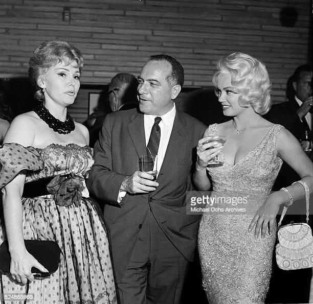 Actress Mamie Van Doren attends an event as she listens to Zsa Zsa Gabor in Los AngelesCA