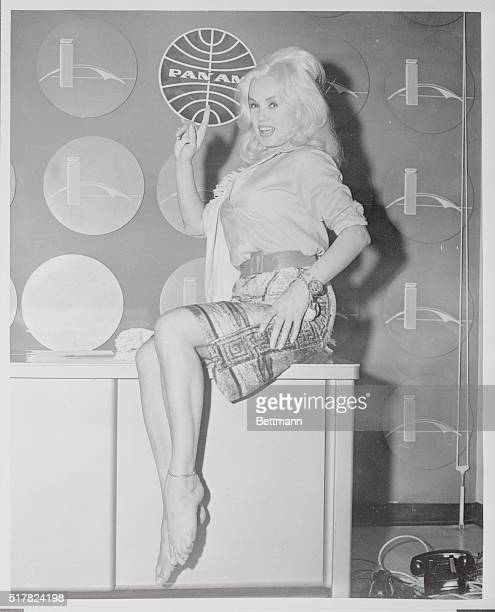 Actress Mamie Van Doren is shown at Idlewild airport after flying in from south of the equator August 6 where she became a sensation at a party when...