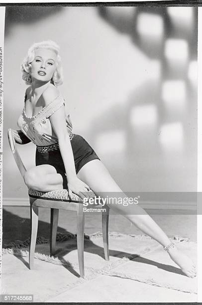Actress Mamie Van Doren married for two months admits she now wears enough clothes to lead a parade in contrast to her premarital days of not wearing...