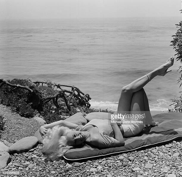Actress Mamie Van Doren poses at the beach in Los AngelesCA
