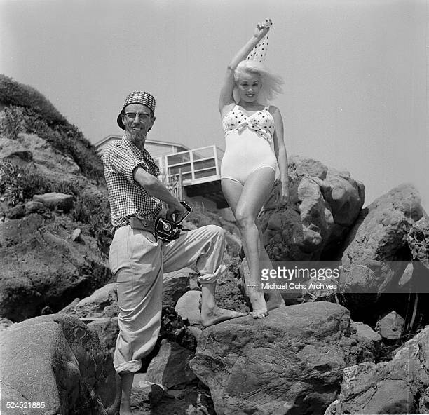 Actress Mamie Van Doren poses at the beach with photographer Earl Leaf in Los Angeles,CA.