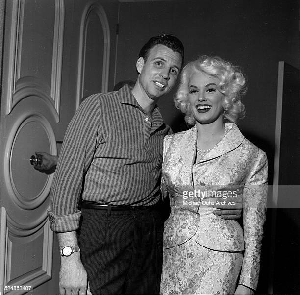 Actress Mamie Van Doren poses with a friend during a party in Los Angeles,CA.
