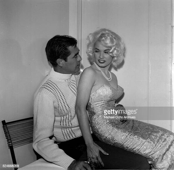 actress mamie van doren sits on the lap of actor steve
