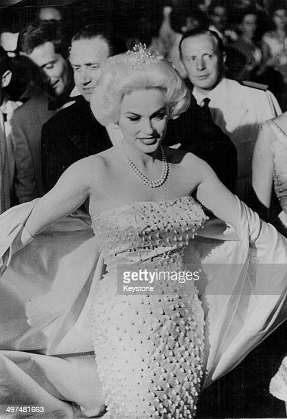 Actress Mamie Van Doren sitting showing off her gown as she arrives at the premiere of the film 'Man in a Rickshaw', at Venice Film Festival, Italy,...