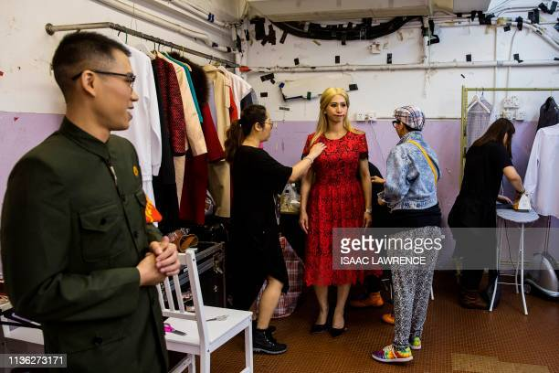 Actress Man Chan dressed as Ivanka Trump gets ready back stage during a rehearsal of a Cantonese opera called Trump on Show in Hong Kong on April 11...