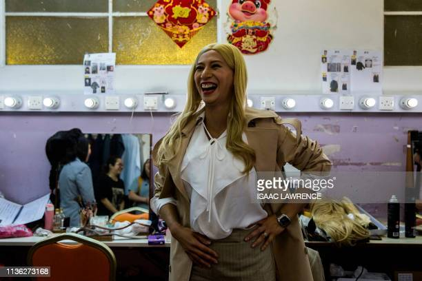 Actress Man Chan dressed as Ivanka Trump reacts back stage during a rehearsal of a Cantonese opera called Trump on Show in Hong Kong on April 11 2019...