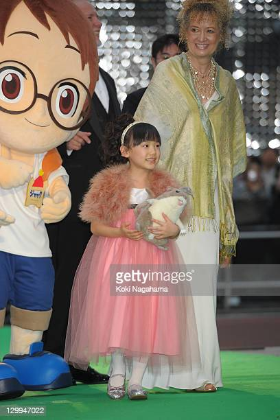 Actress Mana Ashida walks on the green carpet during the Tokyo International Film Festival Opening Ceremony at Roppongi Hills on October 22, 2011 in...
