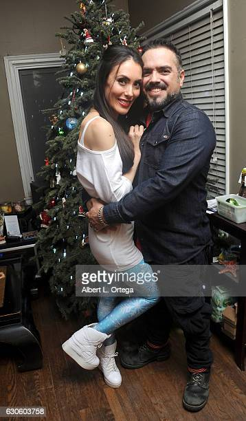 Actress Mandy Amano and director Steven Ayromlooi pose in front of their Christmas Tree on December 27 2016 in Los Angeles California