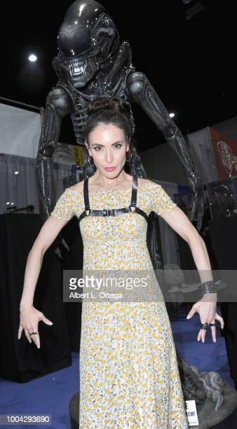 Actress Mandy Amano poses with a Xenomorph from Alien on Sunday day 4 of 2018 ComicCon International held at the San Diego Convention Center on July...