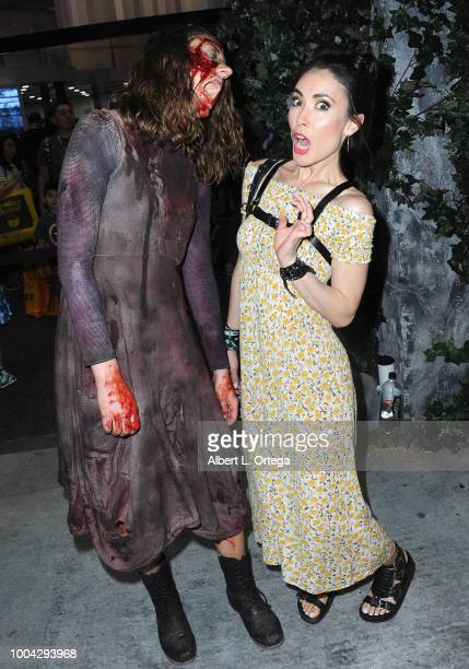 Actress Mandy Amano poses with a Zombie from The Walking Dead on Sunday day 4 of 2018 ComicCon International held at the San Diego Convention Center...