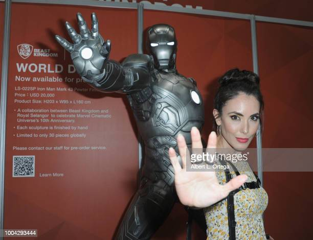 Actress Mandy Amano poses with Iron Man on Sunday day 4 of 2018 ComicCon International held at the San Diego Convention Center on July 22 2018 in San...