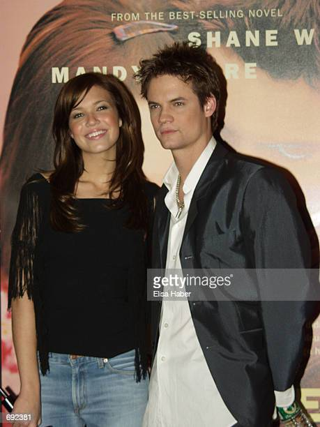Actress Mandy Moore and actor Shane West attend a screening of the film A Walk to Remember January 17 2002 at Planet Hollywood in New York City