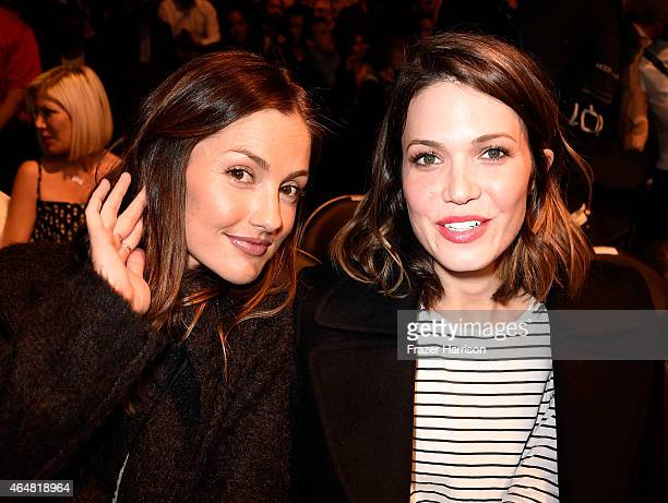 Actress Mandy Moore and actress Minka Kelly in attendance during the UFC 184 event at Staples Center on February 28 2015 in Los Angeles California