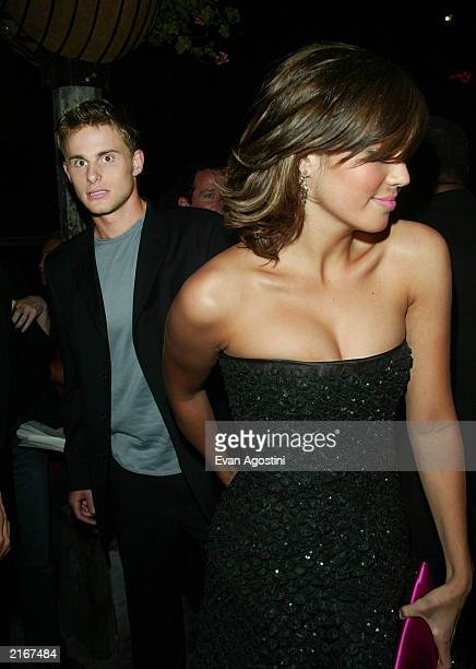 Actress Mandy Moore and companion tennis star Andy Roddick arrive at the premiere of 'How To Deal' afterparty at Lobby July 16 2003 in New York City