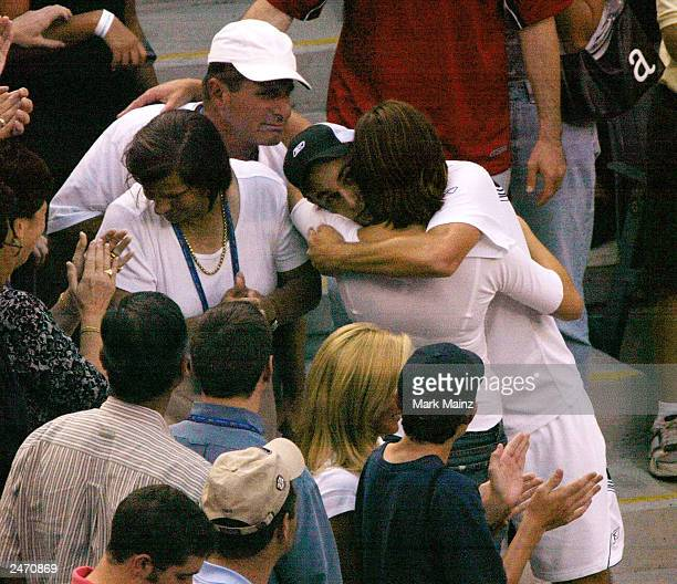 Actress Many Moore hugs tennis player Andy Roddick after he won the '2003 US Open Men's Finals' September 7 2003 in Flushing New York