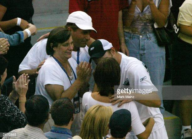 Actress Mandy Moore speaks with tennis player Andy Roddick after he won the '2003 US Open Men's Finals' September 7 2003 in Flushing New York