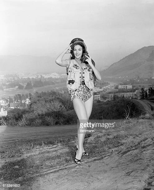 Actress Mara Corday has the distinction of receiving the first honorary title of 1956 She has been named the Go Girl by the 33rd marine air wing...