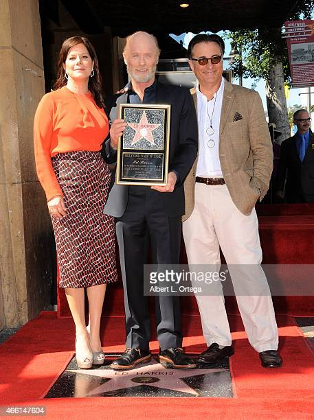 Actress Marcia Gay Harden actor Ed Harris and actor Andy Garcia at the Ed Harris Star ceremony held on the Hollywood Walk Of Fame on March 13 2015 in...
