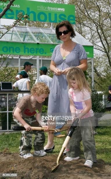 Actress Marcia Gay Harden and her children Hudson Harden Scheel and Julitta Dee Harden Scheel help plant one of the 120 trees planted to celebrate...