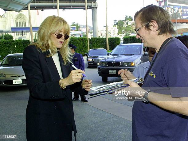 Actress Marcia Strassman signs an autograph for a fan at the 2003 TCA Press Tour on January 7 2003 in Hollywood California