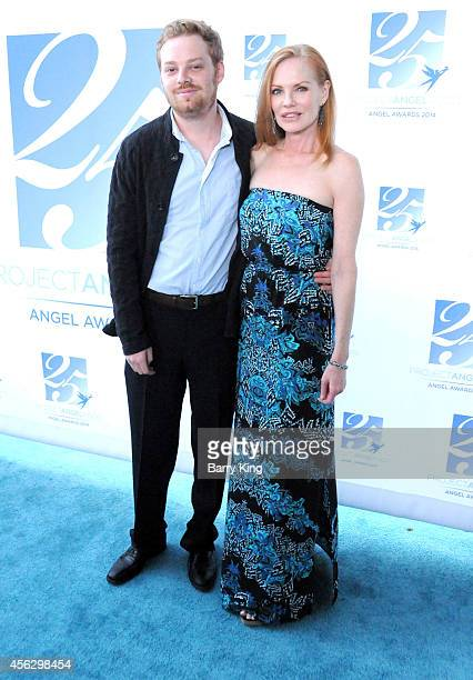 Actress Marg Helgenberger and Howard Rosenberg arrive for Project Angel Food Celebrates 25 Years With 2014 Angel Awards at Project Angel Food on...