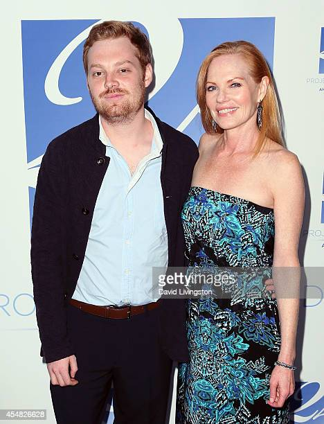 Actress Marg Helgenberger and son Hugh Howard Rosenberg attend the 2014 Angel Awards at Project Angel Food on September 6 2014 in Los Angeles...