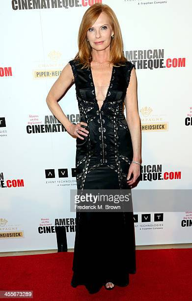 Actress Marg Helgenberger arrives at the 27th American Cinematheque Award honoring Jerry Bruckheimer at The Beverly Hilton Hotel on December 12, 2013...