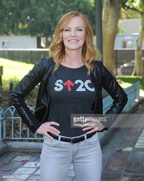 Actress Marg Helgenberger attends the Stand Up To Cancer Press Conference at Los Angeles City Hall on August 27 2014 in Los Angeles California