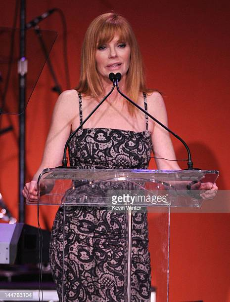 Actress Marg Helgenberger speaks onstage at the 19th Annual Race to Erase MS held at the Hyatt Regency Century Plaza on May 18 2012 in Century City...