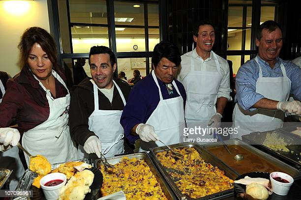 Actress Margaret Colin actor Mario Cantone Ray Halbritter Christopher Cuomo and Regional Sales Director NYC Mike Brzostowski serve food at HELP USA...