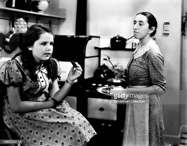 "Actress Margaret Hamilton and Helen Parrish in a scene from the movie ""There's Always Tomorrow"""
