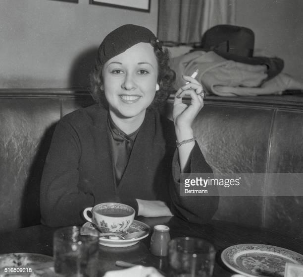 Actress Margaret Lindsay Having Cigarette at Brown Derby Cafe