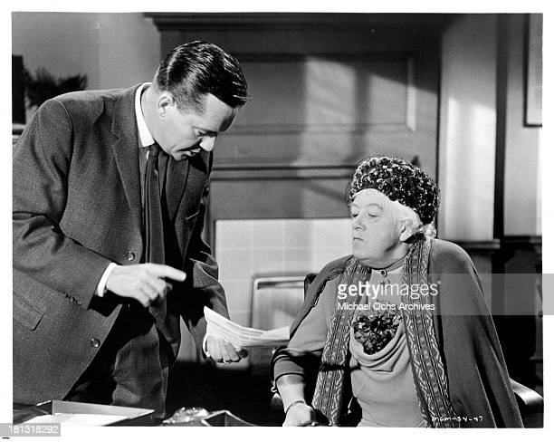 """Actress Margaret Rutherford and actor Charles Tingwell on the set of the movie """"Murder Most Foul"""" in 1964."""