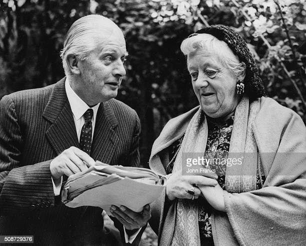 Actress Margaret Rutherford and her husband actor Stringer Davis pictured reading a script outdoors during rehearsals for a BBC performance of 'The...
