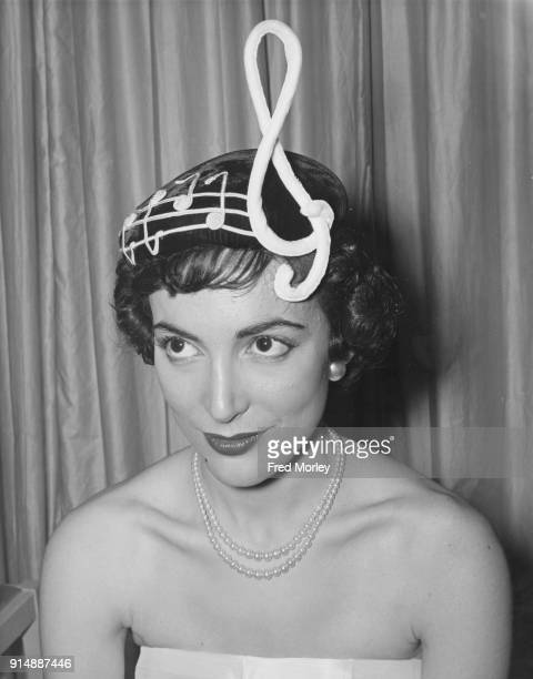 Actress Margo Lorenz wearing a 'Treble Clef' hat from Madge Chard's new collection inspired by the MGM film 'Rhapsody' London 28th June 1955 The...