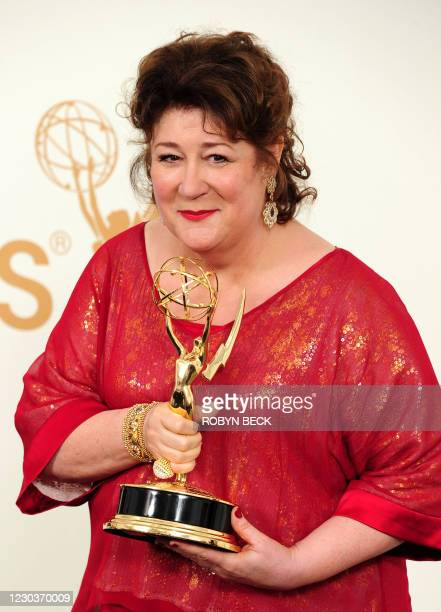 Actress Margo Martindale holds the award for Outstanding Supporting Actress in a Drama Series in the press room at the 63rd annual Primetime Emmy...