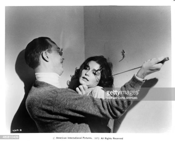 Actress Margot Kidder and actor William Finley in a scene from the movie 'Sisters' circa 1973