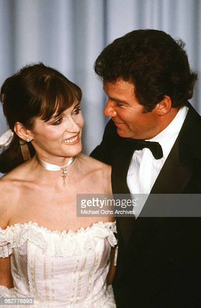 Actress Margot Kidder poses with actor William Shatner backstage during the 55th Academy Awards at Dorothy Chandler Pavilion Los Angeles California