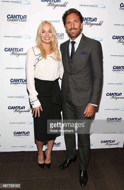 Actress Margot Robbie and hockey player Henrik Lundqvist attend the annual Charity Day hosted by Cantor Fitzgerald and BGC at Cantor Fitzgerald on...