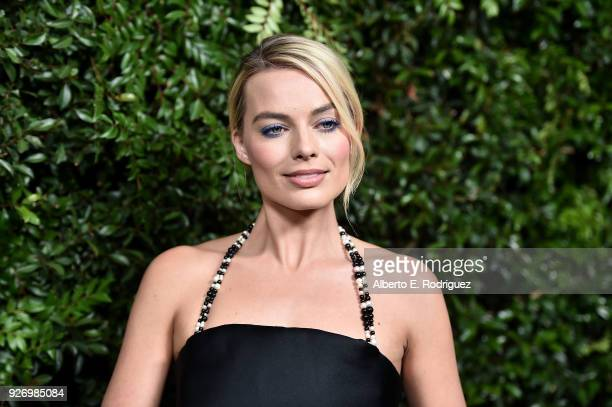 Actress Margot Robbie attends Charles Finch and Chanel's PreOscar Awards Dinner at Madeo Restaurant on March 3 2018 in Los Angeles California