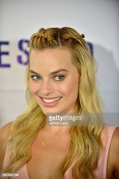 Actress Margot Robbie attends the 'Suicide Squad' Wynwood Block Party and Mural Reveal with cast on July 25 2016 in Miami Florida