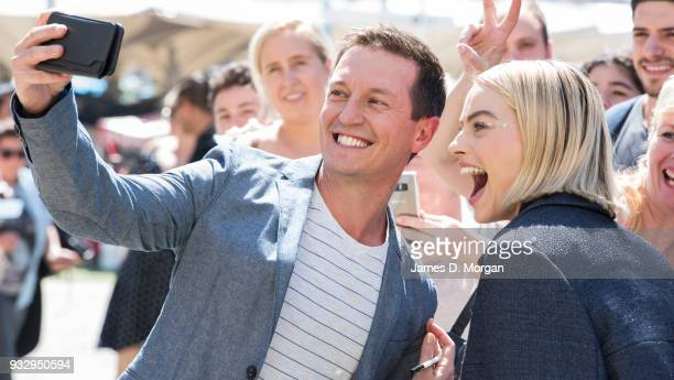 Actress Margot robbie has a selfie with Australian personality Rove McManus as they attend the Peter Rabbit Australian Premiere on March 17 2018 in...