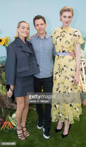 Actress Margot Robbie left and Elizabeth Debicki join director Will Gluck as they attend the Peter Rabbit Australian Premiere on March 17 2018 in...