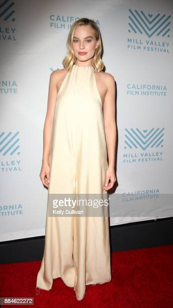 Actress Margot Robbie poses for photos on the red carpet for a premiere of 'I Tonya' at the Christopher B Smith Rafael Film Center on December 2 2017...
