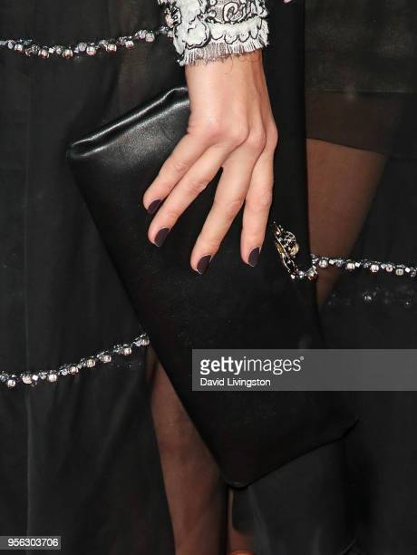 Actress Margot Robbie purse detail attends the premiere of RLJE Films' 'Terminal' at ArcLight Cinemas on May 8 2018 in Hollywood California
