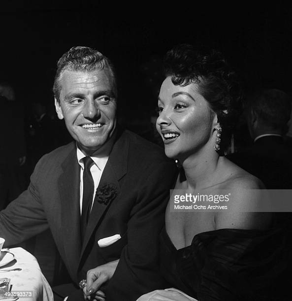 Actress Mari Blanchard with attorney Greg Bautzer attend a premiere in Los Angeles California