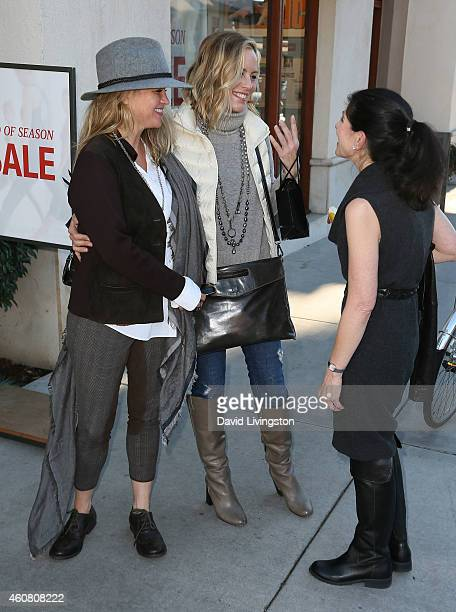 Actress Maria Bello and Clare Munn greet Dorothy Livingston while holiday shopping on Montana Ave on December 23 2014 in Santa Monica California