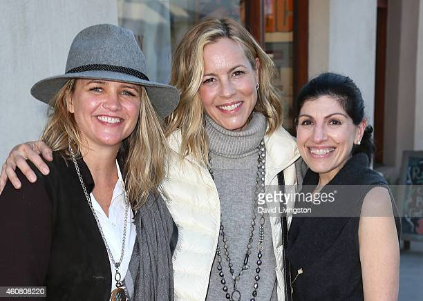 Actress Maria Bello and Clare Munn pose with Dorothy Livingston while holiday shopping on Montana Ave on December 23 2014 in Santa Monica California